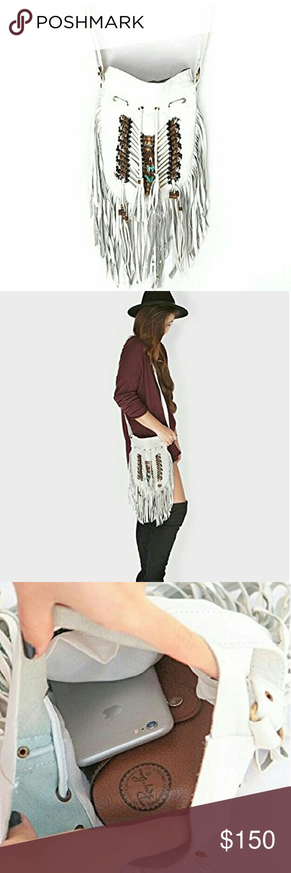 White Indian dream celibrity hobo leather handbag This is not the cheap one high quality   Boho Bag Round S | Real Leather | Fringe Purse | Bohemian Bags with bead work people will notice you when you walk in the room The soft exterior leather of this 100% handmade hobo bag offers timeless style with quality finishes at an affordable price. The interior is incredibly spacious giving you enough room to store items for all your daily essentials. Simply an awesome leather bag to add some summer…