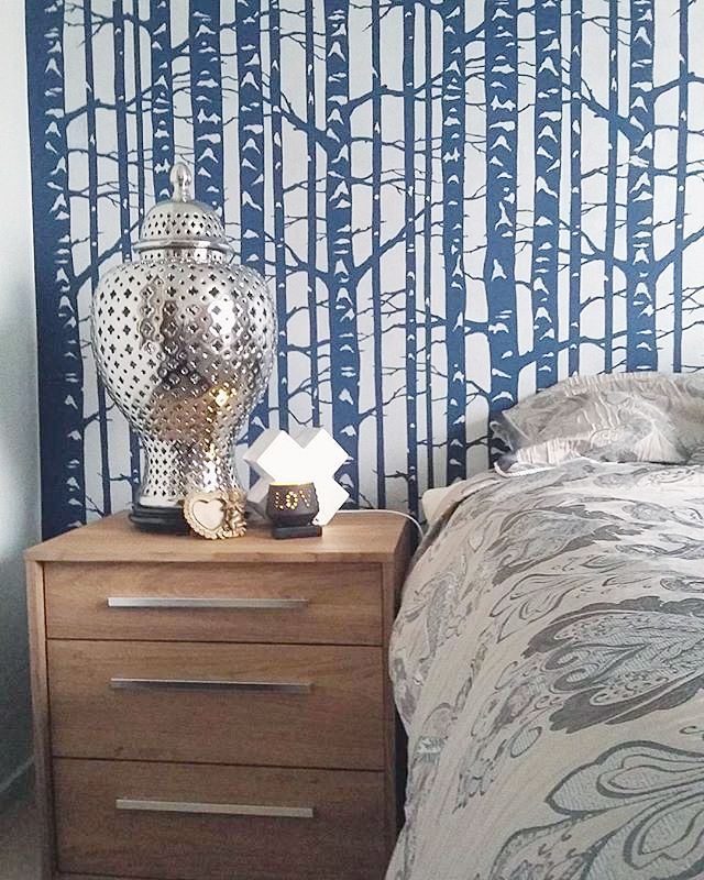 DIY stenciled accent wall in a guest bedroom using the Birch Forest ...