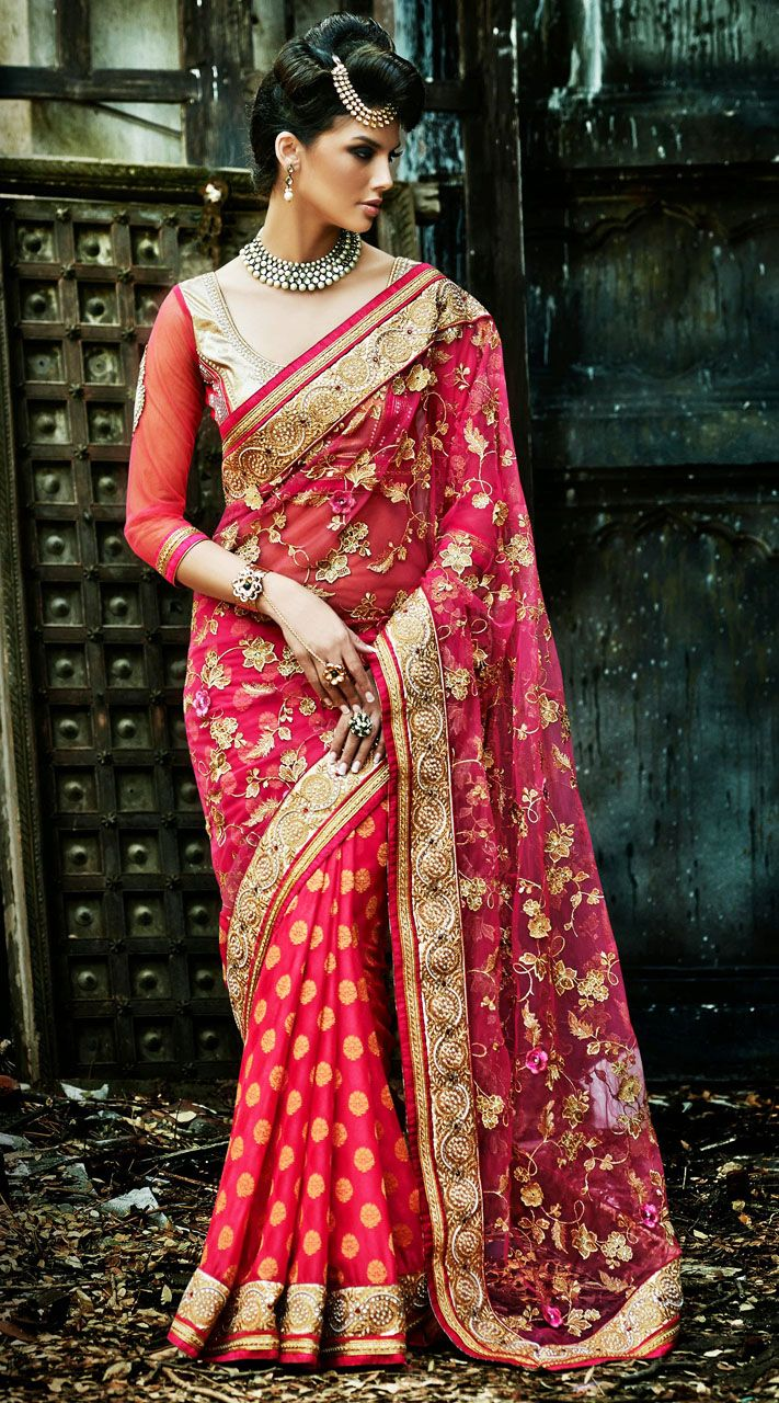 Lovely reddish pink banarasi silk and faux georgette border saree which is finished with the fine work of lace, resham and stone. This sari comes with matching blouse piece. The blouse of this saree can be stitched in the maximum bust size of 42 inches. Product Code  3FD4544975