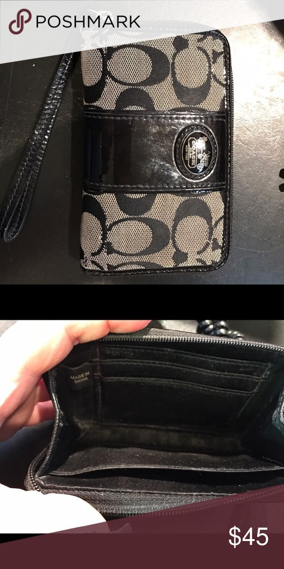 Coach Zip Around Wallet Black signature style wallet. Three interior card slots and interior pocket. Regular iPhone fits in also. Wrist band makes for easy carrying. Bags Wallets