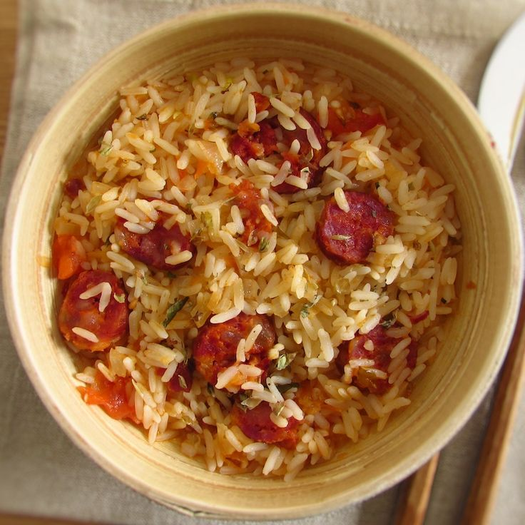 Chorizo rice | Food From Portugal. The chorizo is a very popular sausage in Portugal that always gives a special touch to the meals. If you do not know what to do for lunch or dinner this chorizo rice recipe is ideal for you. It's simple and very quick to prepare!   http://www.foodfromportugal.com/recipe/chorizo-rice/