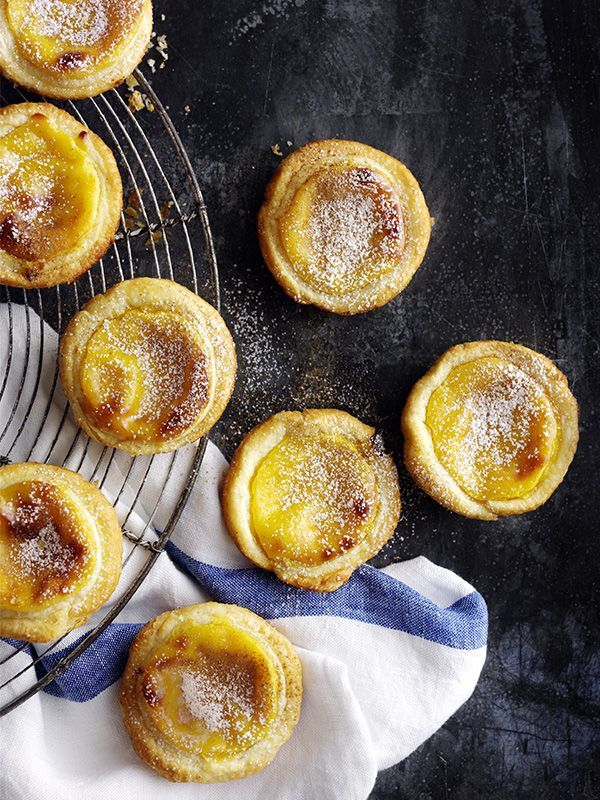 Make classic Portuguese custard tarts with step-by-step help from the olive test kitchen. Dusting the pastry with icing sugar gives the tarts a golden, caramelised crust when cooked.