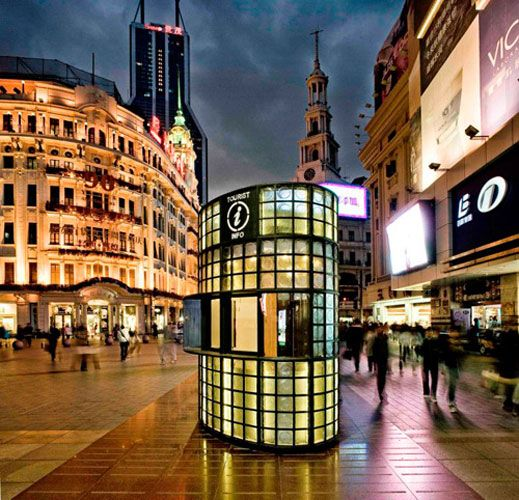 The art-deco inspired custom-made pattern glass panels of these kiosks in Shanghai on Nanjing Road echo the historic architecture of the neighborhood