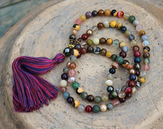 Mala necklace made of 108, 7 and 8 mm - 0.275 and 0.315 inch, beautiful smooth and faceted gemstones such as agate, jasper, pearl, shell pearl and quartz. The guru bead is a faceted hematite stone.  The total length of the mala necklace is approximately 89 cm - 35 inch.