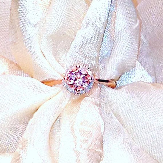 Morganite Halo Ring or Engagement Ring, Handmade Jewelry By NorthCoastCottage Jewelry Design & Vintage Treasures. Here is a rare Cor de Rosa Morganite round set in 14k rose gold with a white topaz halo. Only 2 available, one size 6 and one size 8. Rose gold brings out the best in