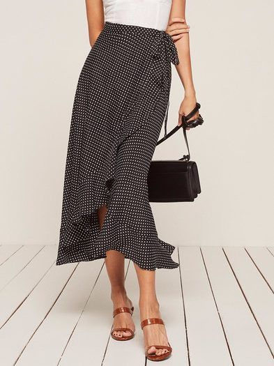 Talk romance to me.  This is a midi length, wrap skirt with a ruffle edged hem and high slit.