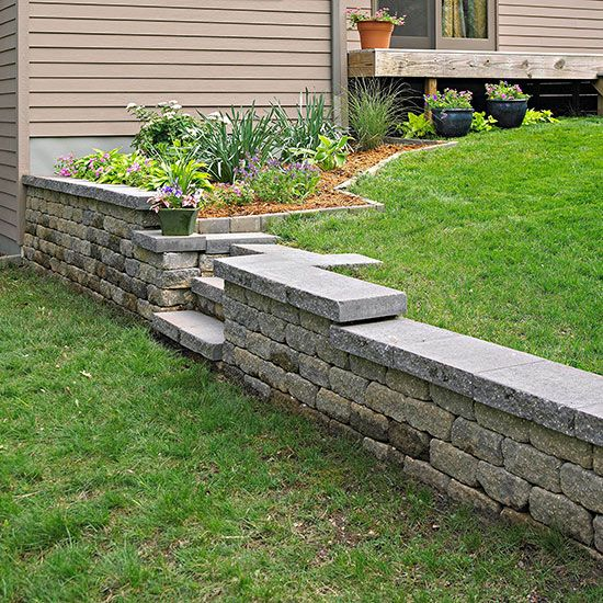 Build a retaining wall conquer a problem slope by installing a build a retaining wall conquer a problem slope by installing a concrete block retaining wall youll add space structure and value to your backyard solutioingenieria Images