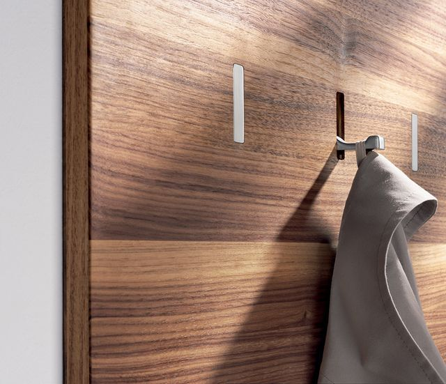 Lately we've been admiring polished versions of the retractable wall hooks used on planes, trains, and boats. Here are three versions at three very different prices. Now if only our clothes, tools, an