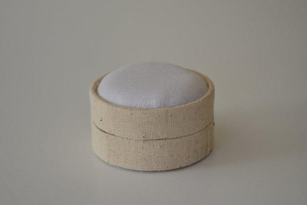LBSrnd.80 - Small Round - Light Linen covered and lined boxes make it so easy for you to create a special gift or precious keepsake. Embellish your fabric as you desire, cover the removable, padded lid with your worked fabric and replace into the box lid. The box measures 8.5cm in diameter.