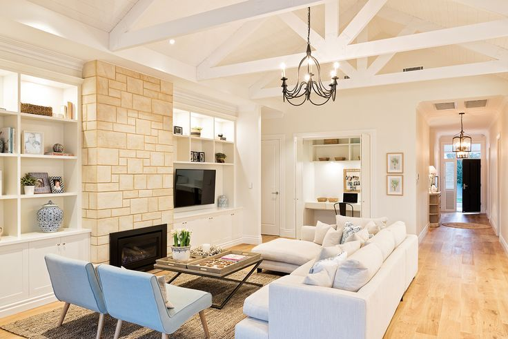 The living room of my Hamptons style home. The stone fireplace was recycled from the original house and cut into tiles. Built by Scott Salisbury Homes and designed by Amity Dry.