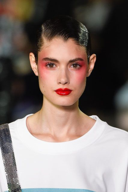 The 6 Coolest Hair & Makeup Trends You'll Be Wearing Soon #refinery29  http://www.refinery29.com/2016/09/123393/best-hair-makeup-trends-nyfw-pat-mcgrath-ss17#slide-12  While we might not have the guts to pull off the intense blush draping we saw at Kenzo, we're copying the patent-red lips tonight by layering clear gloss over our go-to matte....