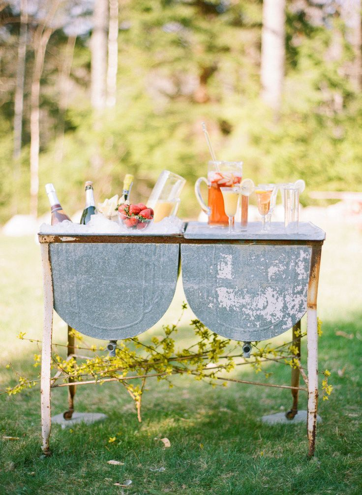 What's more fun than a DIY pre-ceremony cocktail? This rustic station was stocked with all the necessities for sangria, mimosas, and bellinis.