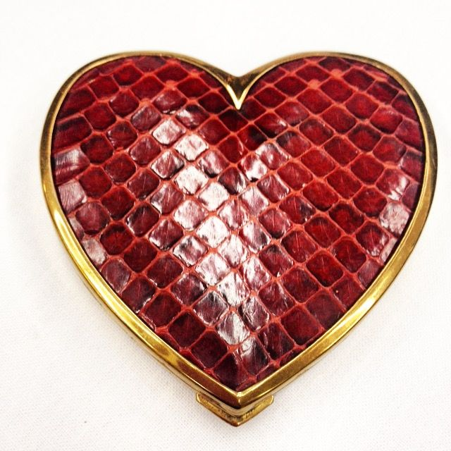 Vintage heart shaped compact brass and raspberry snakeskin.