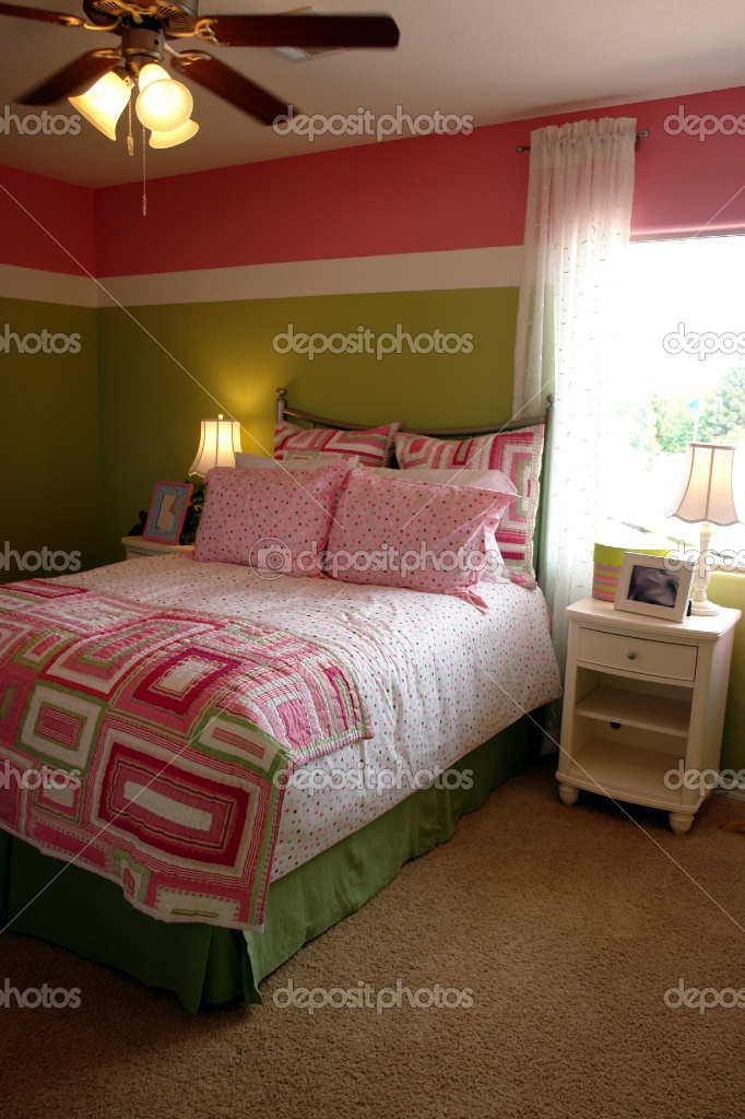 pink and green wall colors for girls bedroom | Pink and green girls bedroom with two-tone wall paint.