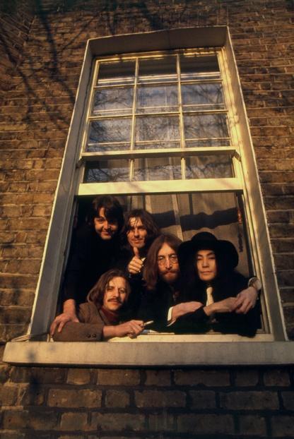Window of 7 Cavendish Avenue, St. John's Wood, London. Paul, George, Ringo, John, Yoko, taken by Linda Eastman McCartney.