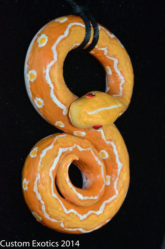 Albino Sun Citron Tiger Reticulated Python hand by CustomExotics