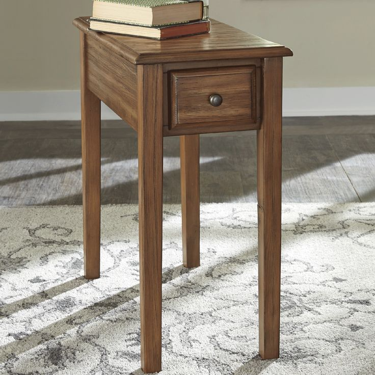 Make life simple in a stylish way with this solid wood end table. Not only will the drawer come in handy, but the built-in charging station will deliver the convenience of keeping electronic devices charged from your seat. Its warm brown finish and tapered legs enable this narrow table to easily pair with other contemporary decor in tight spaces.
