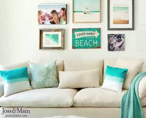 Gallery Wall Above The Sofa With Beach Art And Photography Plus A