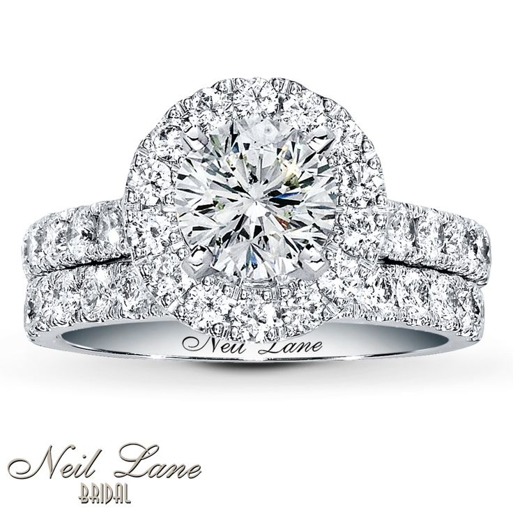 Inspired by vintage Hollywood style, beautifully staged by Neil Lane. Exquisite round diamonds brilliantly frame the center, while a line of round diamonds fans out on either side of the engagement ring setting. The matching wedding band features a row of round diamonds to complement the engagement ring. Each Neil Lane Bridal® ring is hand-crafted and undergoes a four-step polishing process which gives each ring its beautiful shine and luster. The total diamond weight for the bridal ...
