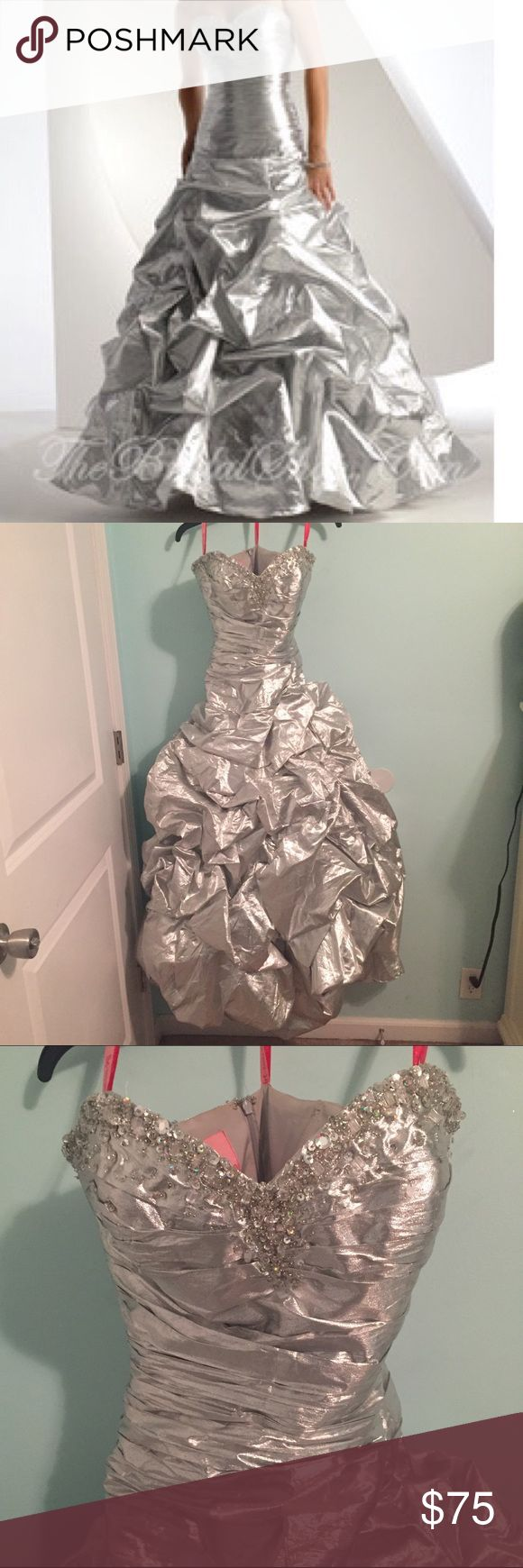Flirt by Maggie Sottero Silver Metallic Prom Dress Beautiful ball gown style dress in a metallic silver color. Features a corset back to make your waist look it's best and then a zipper over that to hide it. Only worn once and still in good condition but there the bottom of the zipper is messed up a little (there's some threads coming off which makes it a little hard to Zip but nothing serious). Also one of the runches came loose as you can see in the back but it's not super noticeable and…