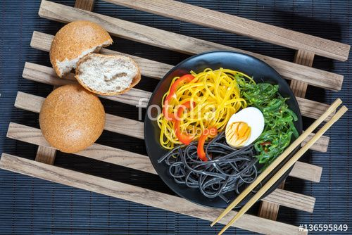 "Download the royalty-free photo ""Hiyashi wakame with sesame and nut sauce, black and corn noodles, boiled egg. Bran bread. The rustic wooden lattice, black makisu"" created by Victoria Kondysenko at the lowest price on Fotolia.com. Browse our cheap image bank online to find the perfect stock photo for your marketing projects!"