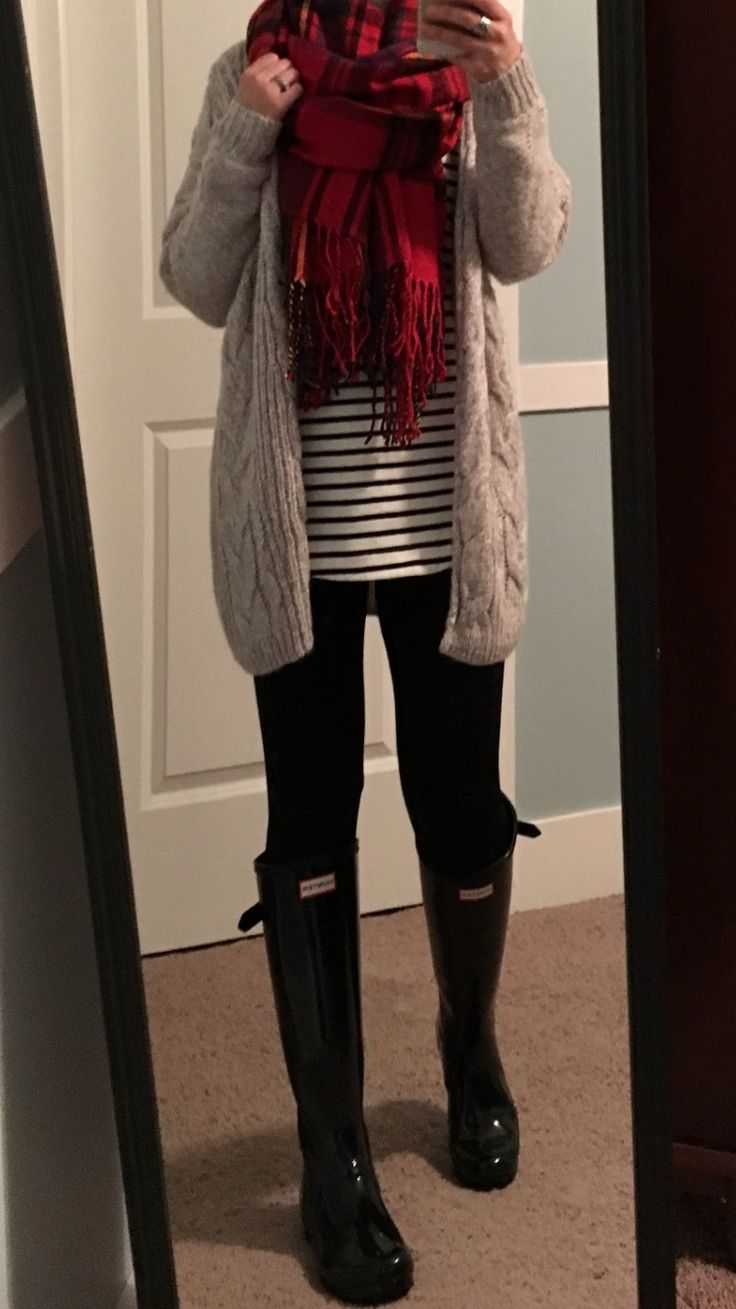 Light grey chunky cardigan, black and white striped top, black leggings, black Hunter boots, red plaid blanket scarf.