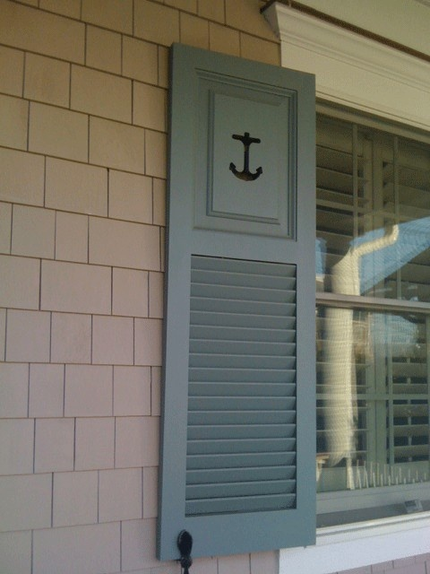 Custom combination shutters with Panel and Louvered shutters and an anchor cut out.