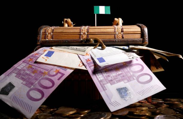nigerian flag on top of crate full of money