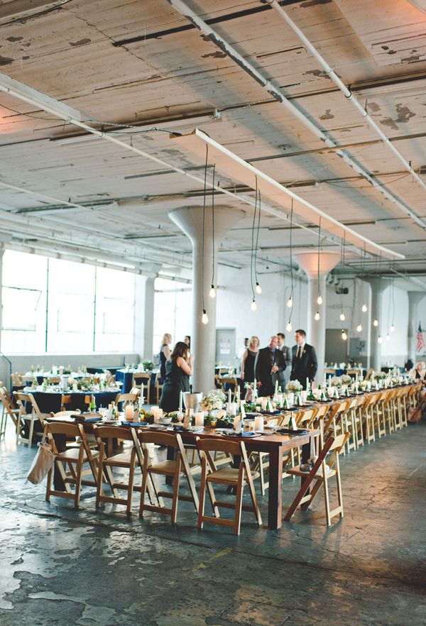 industrial reception, photo by Mallory and Justin Photographers http://ruffledblog.com/glam-wedding-in-a-cleveland-warehouse #weddingreception #receptions #tablescape