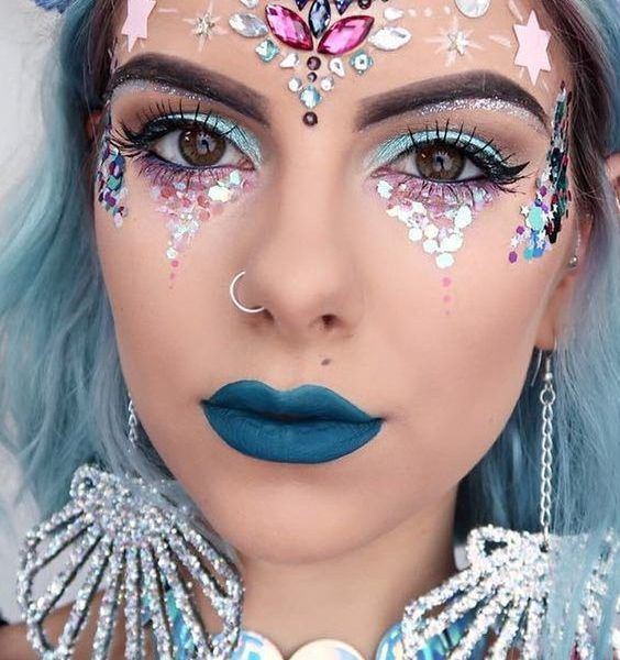 Mermaid - The Makeup: Apply a metallic blue shadow and pair with a turquoise lipstick. Embellish with glitter, rhinestones, seashells, anything.The Outfit: There's literally no more appropriate time to wear a mermaid skirt. Complete the look with a sequined top and costume jewels.