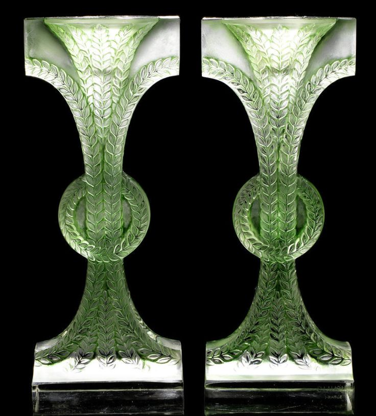 René Lalique  'Rameaux' a Pair of Candlesticks, design 1934  frosted glass, heightened with green staining  20cm high, etched 'R. Lalique France'