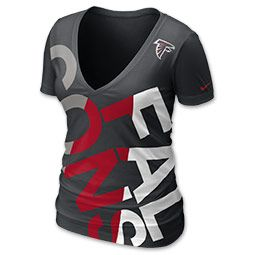 The Nike NFL Off Kilter Women's V-Neck Tee Shirt features a deep v-neck, form flattering fit, and a fun diagonal bold screen print team name in team colors across the chest. Wear this tee shirt to the next big game or while cheering from home. Show your team spirit!