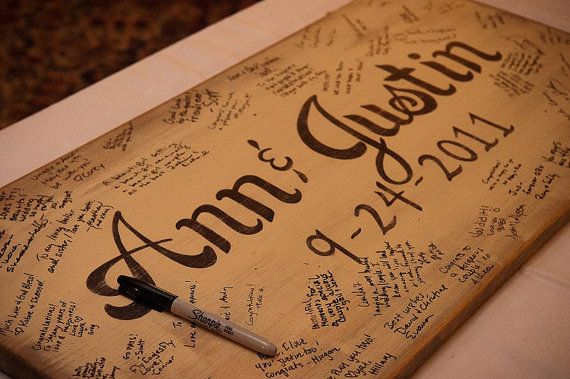 Instead of a book, just one big board - you burn the names and date and everyone else uses a pen.    Wedding Guest Book