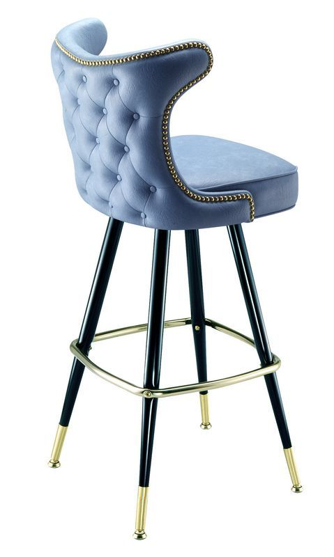 This restaurant bar stool is made by Richardson Seating in Chicago Each nail is hit