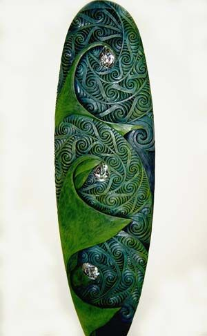 Māori design carved surf board. inspired by the way killer whales hunt sting rays