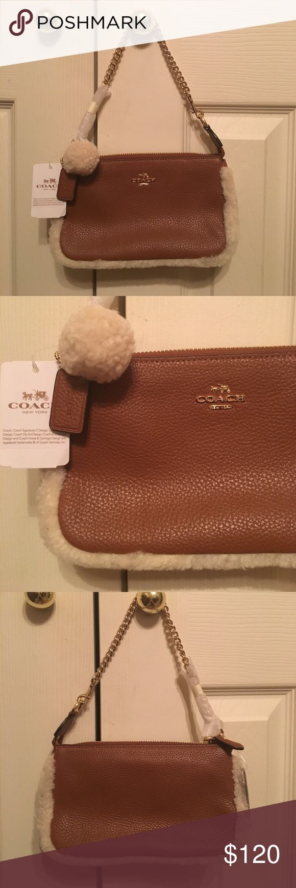 NWT coach clutch absolutely stunning ❤💕💋🌹💗 Brand new brown coach clutch bag!! NWT and never been used. Perfect going out bag!! ❤😊😘💋💕🌹❤️😍.. two Michael Kors and one coach ... Coach Bags Clutches & Wristlets