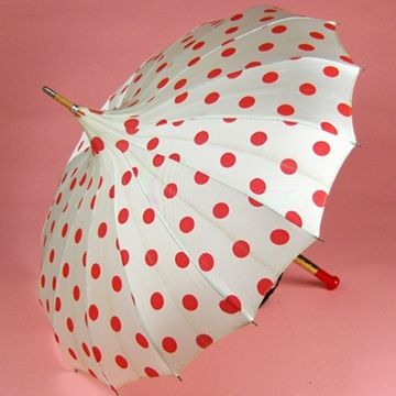 Cute!   White pagoda umbrella with large red polka dots. Wooden post with red Bakelite pillar handle.