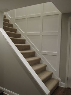 Opening downstairs entry by cutting away wall and adding trim to create wainscoting
