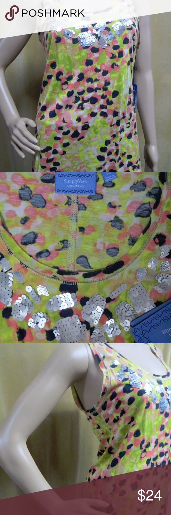 "Simply Vera Wang Sequin Dot Tank Top New Petite NWT New Retail $44.00 Pullover Scoop neckline Sleeveless Allover mig dot printed watercolor Silver sequin applique bodice Straight hem, lightweight, silky soft touch 100% rayon Hand wash Size PXS:     Chest 15"" across front and length from shoulder to hem 24"". Size PS :     Chest 15.5"" across front and length from shoulder to hem 25"". Simply Vera Vera Wang Tops Blouses"