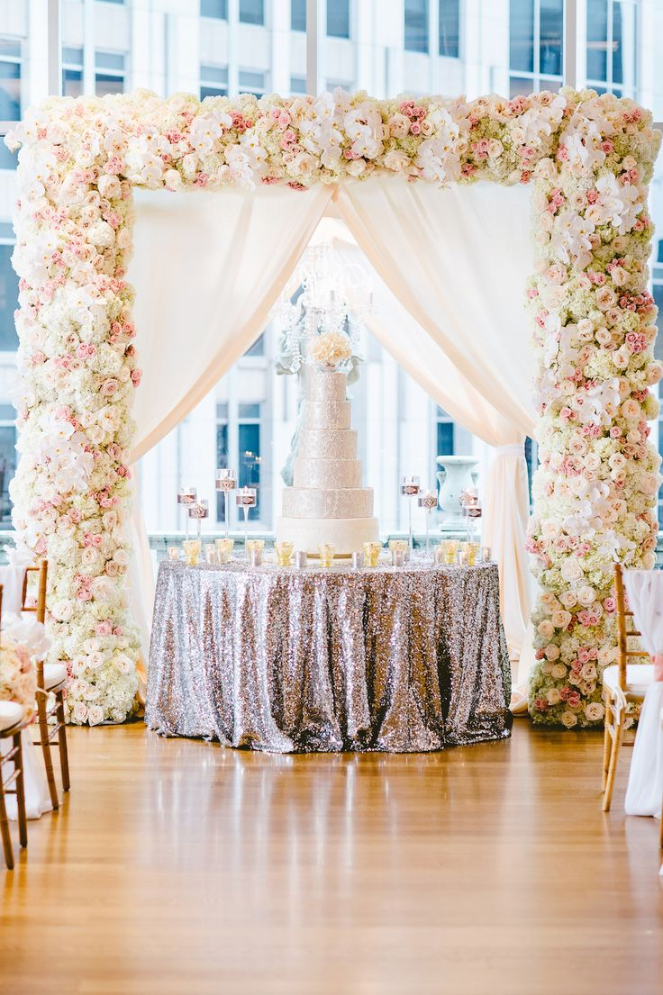 Silver Cake on Sequin Table at Ceremony | Photography: Crystal Stokes Photography. Read More: http://www.insideweddings.com/weddings/white-blush-inspirational-wedding-shoot-at-urban-rooftop-garden/714/