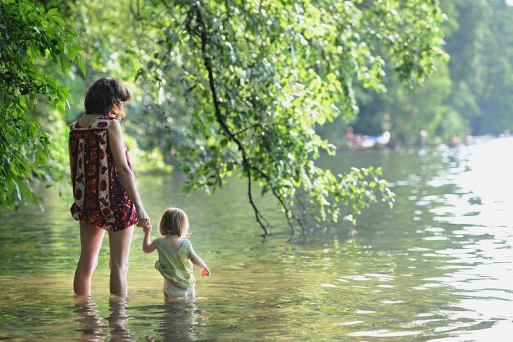 SCENIC: A mother and child stood in shallow waters of Schlachtensee Lake as temperatures were on the rise in Berlin Thursday. (Ole Spata/European Pressphoto Agency)