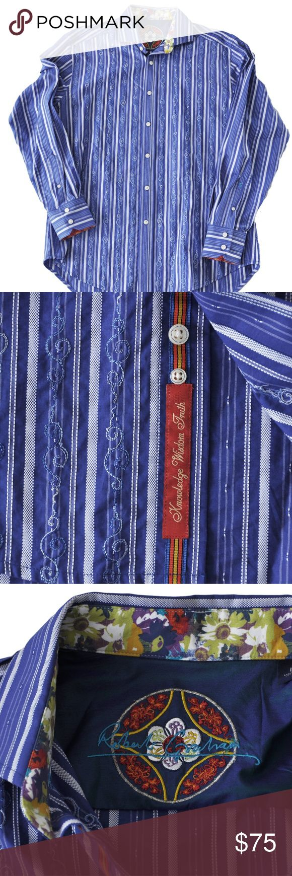 """Robert Graham Large Stripes Embroidered Contrast ROBERT GRAHAM  Blue and white stripes with embroidered design Contrasting red, yellow, and blue cuffs and underside of collar Robert Graham's Signature """"Knowledge, Wisdom, Truth"""" is embroidered below buttons 100% Cotton Body; 100% Silk Trim Dry Clean Approximate measurements taken flat across Shoulder to Shoulder: 20"""" Underarm to Underarm: 24.5"""" Sleeve Length: 25.5"""" (from shoulder hem to end of cuff) Length: 34"""" (Measured on back side, from…"""