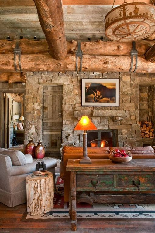 Rustic Living Room with Exposed beam, Cowboy ceiling light fixture, Hardwood floors, Built-in bookshelf, flush light