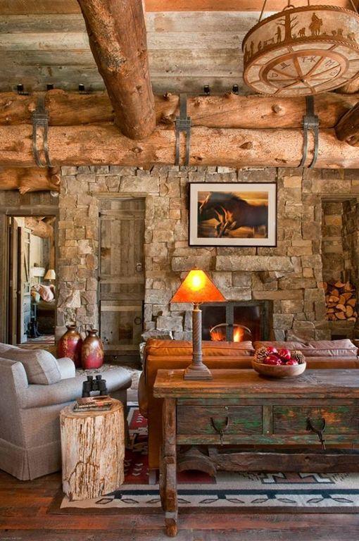 Rustic Living Room with Exposed beam, Cowboy ceiling light fixture, Hardwood floors, Built-in bookshelf, flush light
