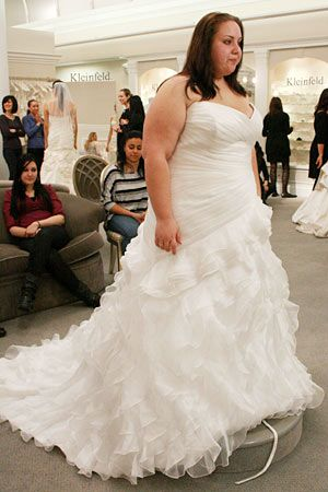 A plus size gown with beautiful ruffled train!