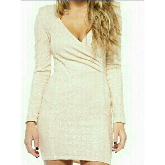 AX PARIS Nude Sequin Long sleeve bodycon dress Gorgeous long sleeve Nude Sequin Dress. Never before worn. Perfect for a celebration or a party. It kills me to sell this but it can't fit and makes no sense to keep it just to have it. The price is set and firm, however if it's a reasonable offer I'll consider it. Happy Shopping. Dresses Mini