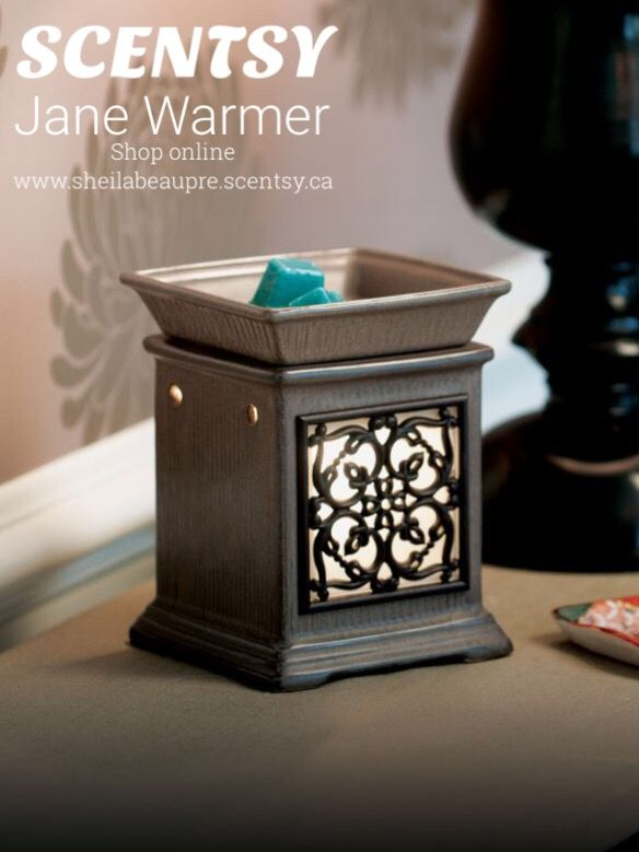 SCENTSY WARMER  LIFETIME WARRANTY  Scrolling, wrought-iron details frame Jane's romantic glowing window, set in an Edwardian-inspired column.