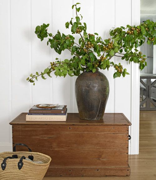 Balance the heft of long Asian Pear branches with an equally sizable container. Start by placing your tallest cuttings in the middle, and fan out with the shorter ones from there.