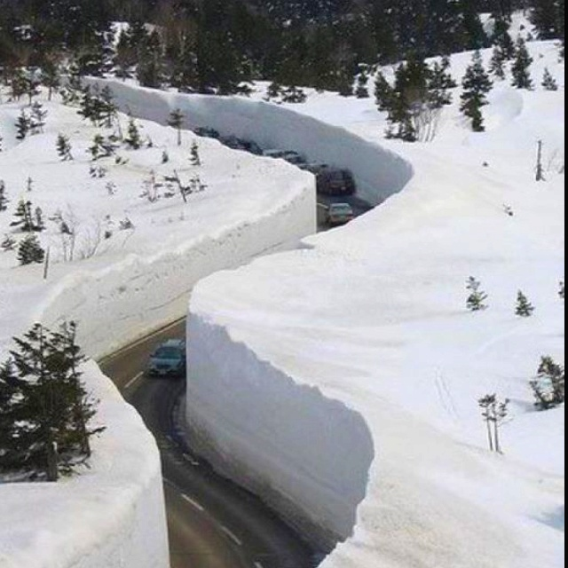The 2012 snow in Alaska.  You wouldn't see much scenery driving on this road......  Our grandson, Andrew, is serving a mission in Alaska and is in Valdez.  It is supposed to get the deepest snowfall in the world.  This picture may have been taken there.....Pat