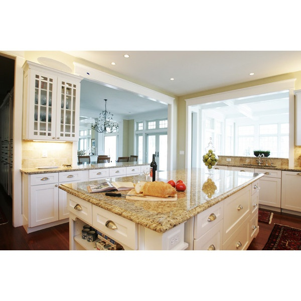 white cabinets with new venetian gold granite and dark wood floors. My ideal kitchen! (minus the modern-ish look)